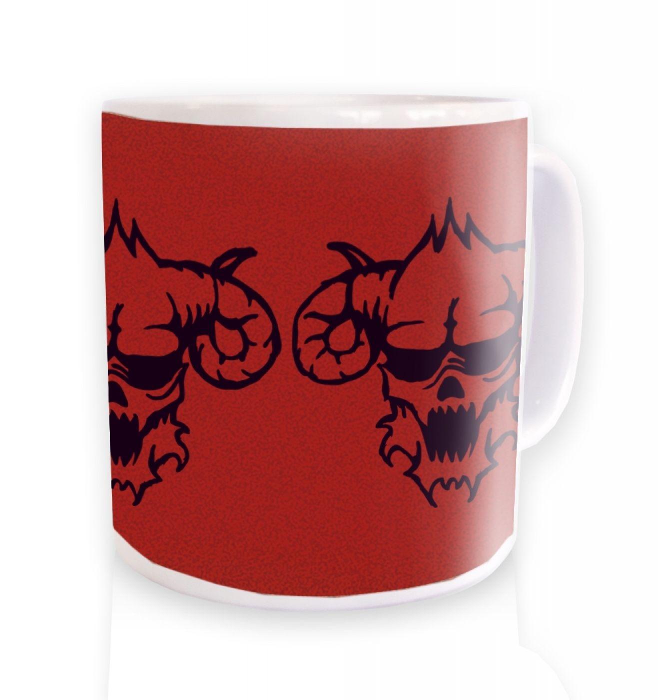 Three Black Demon's Heads ceramic coffee mug